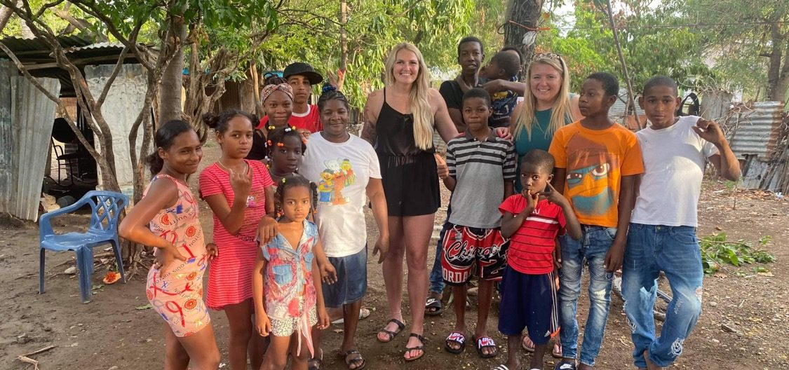 A 4North volunteer smiling with Dominican children